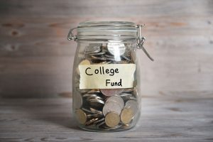 coins in a jar labeled college fund